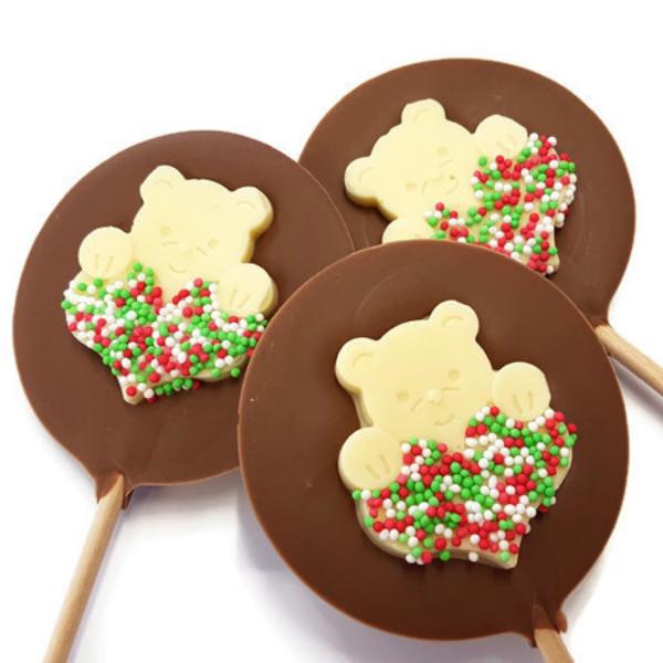 Teddy holding heart chocolate lolly